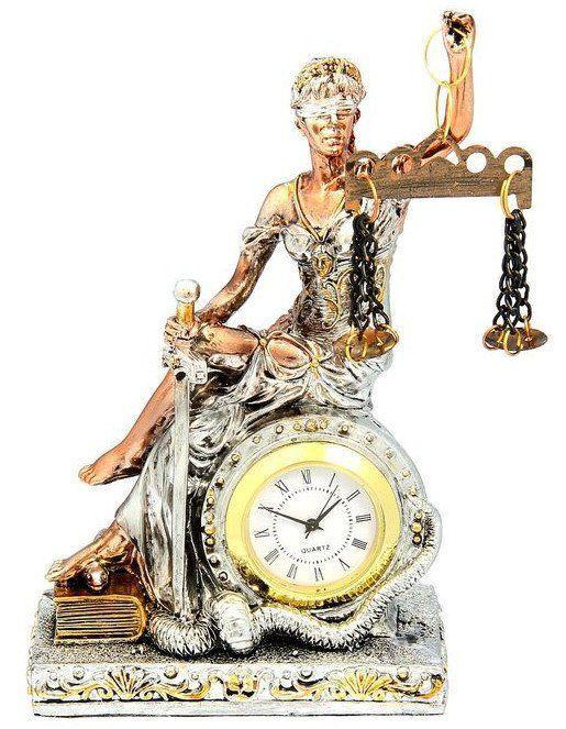 Часы сувенирные ФемидаЧасы<br>Вряд ли найдется человек, который бы не был знаком с изображением Фемиды - богини правосудия. Неотъемлемые атрибуты её облика - повязка на глазах, означающая беспристрастие, весы - знак правосудия, а также меч, символизирующий справедливое возмездие. Суве...<br><br>Год: 2016<br>Высота: 150<br>Ширина: 90<br>Толщина: 50