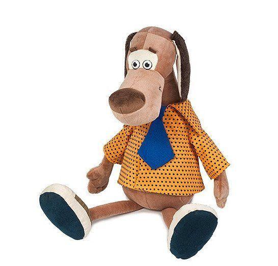 Игрушка мягконабивная Пес Барбос в рубашке, 23 смМягкие игрушки<br>Мягкая игрушка Пес Барбос в рубашке имеет довольно забавный дизайн. Барбос одет в оранжевую рубашку в черный горошек, дополненную непропорционально большим галстуком. Это придает внешнему виду игрушки некую небрежность и даже нелепость, но это как раз-т...<br><br>Год: 2017<br>Высота: 230<br>Ширина: 100<br>Толщина: 100